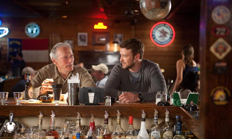 """This film image released by Warner Bros. Pictures shows Clint Eastwood, left, and Justin Timberlake in a scene from """"Trouble with the Curve."""" (AP Photo/Warner Bros. Pictures, Keith Bernstein)"""