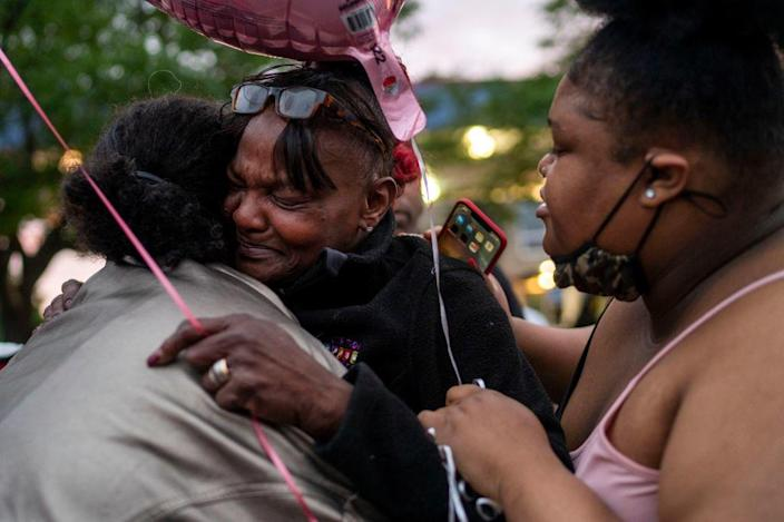Jacqueline Frazier, center, mother of Leneal Frazier, is surrounded by friends and family mourn the death of her son on July 7, 2021, in Minneapolis. / Credit: Leneal Frazier