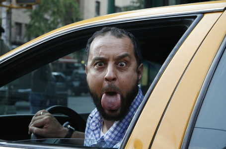 Cab driver sticking out his tongue
