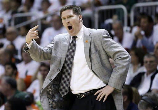 Clemson coach Brad Brownell yells instructions to his players during the first half of a NCAA college basketball game against Miami in Coral Gables, Fla., Saturday, March 9, 2013 against Miami. (AP Photo/J Pat Carter)