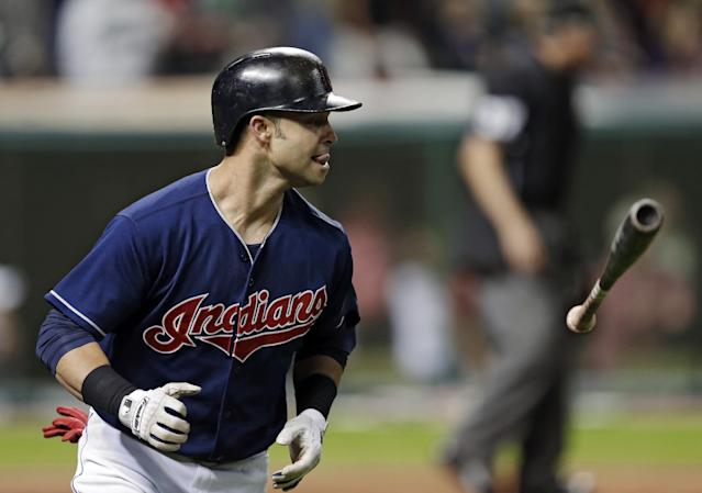 Cleveland Indians' Nick Swisher flips away his bat after a grand slam off New York Mets relief pitcher Tim Byrdak in the eighth inning of a baseball game Friday, Sept. 6, 2013, in Cleveland. (AP Photo/Mark Duncan)