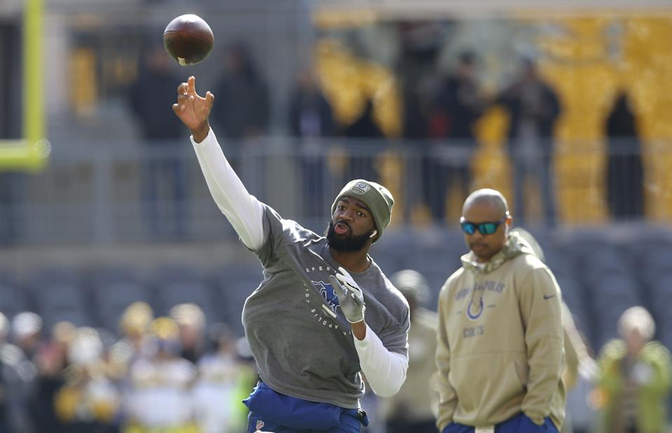 Nov 3, 2019; Pittsburgh, PA, USA;  Indianapolis Colts quarterback Jacoby Brissett (left) throws on the field as the Colts quarterbacks coach Marcus Brady (right) looks on before the game against the Pittsburgh Steelers at Heinz Field. Mandatory Credit: Charles LeClaire-USA TODAY Sports