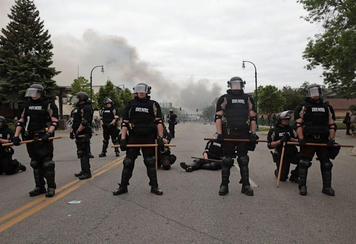 Police officers blocking a road on May 29 in Minneapolis.
