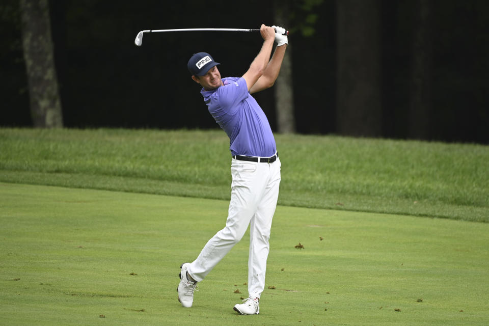 Harris English hits from the second fairway during the third round of the BMW Championship golf tournament, Saturday, Aug. 28, 2021, at Caves Valley Golf Club in Owings Mills, Md. (AP Photo/Terrance Williams)