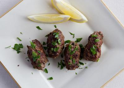 "<div class=""caption-credit""> Photo by: Photo by Kimberley Hasselbrink</div><div class=""caption-title""></div><b>Kofte Meatballs</b> <br> <br> Combine ground beef with grated garlic, beaten egg, grated lemon zest, finely chopped parsley, and ground cumin and cinnamon. Shape into 1-inch-wide cylindrical meatballs. Dust with flour, then pan-fry in vegetable oil until browned and cooked through, about 6 minutes. Squirt immediately with lemon juice."