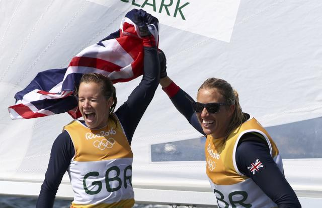 2016 Rio Olympics - Sailing - Final - Women's Two Person Dinghy - 470 - Medal Race - Marina de Gloria - Rio de Janeiro, Brazil - 18/08/2016. Hannah Mills (GBR) of Britain and Saskia Clark (GBR) of Britain celebrate winning gold medal. REUTERS/Benoit Tessier FOR EDITORIAL USE ONLY. NOT FOR SALE FOR MARKETING OR ADVERTISING CAMPAIGNS.