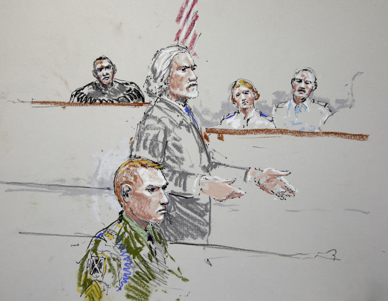 FILE - U.S. Army Staff Sgt. Calvin Gibbs, seated at lower left, is shown in this courtroom sketch as his attorney Phil Stackhouse stands at center, and military Judge Lt. Col. Kwasi Hawks listens, at top left, in this Oct. 31, 2011 file image. A military jury sentenced an Afghan war veteran to life in prison Thursday Nov. 10, 2011 after the Army staff sergeant was convicted of murder, conspiracy and other charges in the deaths of civilians, in one of the most gruesome cases to emerge from the conflict.  (AP Photo/Peter Millett, File)