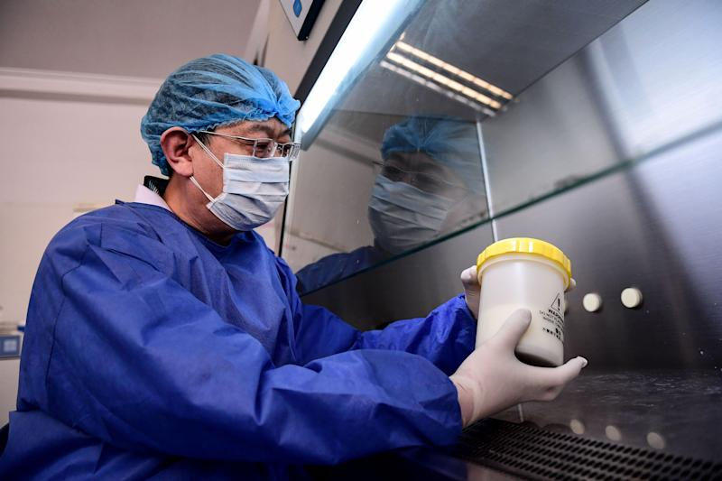 "A laboratory technician works on testing samples from people to be tested for the COVID-19 coronavirus at a laboratory in Shenyang in China's northeastern Liaoning province on February 12, 2020. - The death toll from China's deadly COVID-19 coronavirus epidemic climbed past 1,100 on February 12 but the number of new cases fell for a second straight day, as the World Health Organization urged global unity to combat the ""grave threat"". (Photo by STR / AFP) / China OUT (Photo by STR/AFP via Getty Images)"