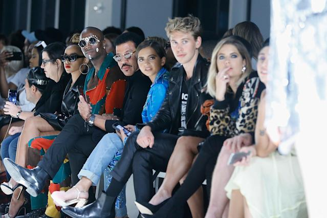 From left: Young Paris, Lionel Richie, Isabela Moner, Austin Butler, Vanessa Hudgens, and Ashley Benson at the Jeremy Scott SS18 show in New York. (Photo: Getty)