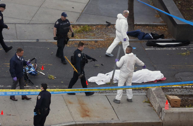 <p>Authorities investigate the scene near a covered body on a bike path after a motorist drove onto the path near the World Trade Center memorial, striking and killing several people, Tuesday, Oct. 31, 2017, in New York. (Photo: Bebeto Matthews/AP) </p>