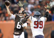 Cleveland Browns quarterback Brian Hoyer (6) throws under pressure from Houston Texans defensive end J.J. Watt (99) in the fourth quarter of an NFL football game, Sunday, Nov. 16, 2014, in Cleveland. (AP Photo/David Richard)