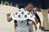 Washington Wizards' Russell Westbrook, right, celebrates with Bradley Beal following an NBA basketball game against the Indiana Pacers, Saturday, May 8, 2021, in Indianapolis. Washington won 133-132 in overtime. (AP Photo/Darron Cummings)