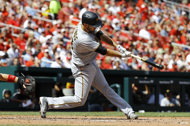 Pittsburgh Pirates' Jacob Stallings hits a two-RBI single, driving in Jordan Luplow and Pablo Reyes during the sixth inning of a baseball game against the St. Louis Cardinals Wednesday, Sept. 12, 2018, in St. Louis. (AP Photo/Billy Hurst)