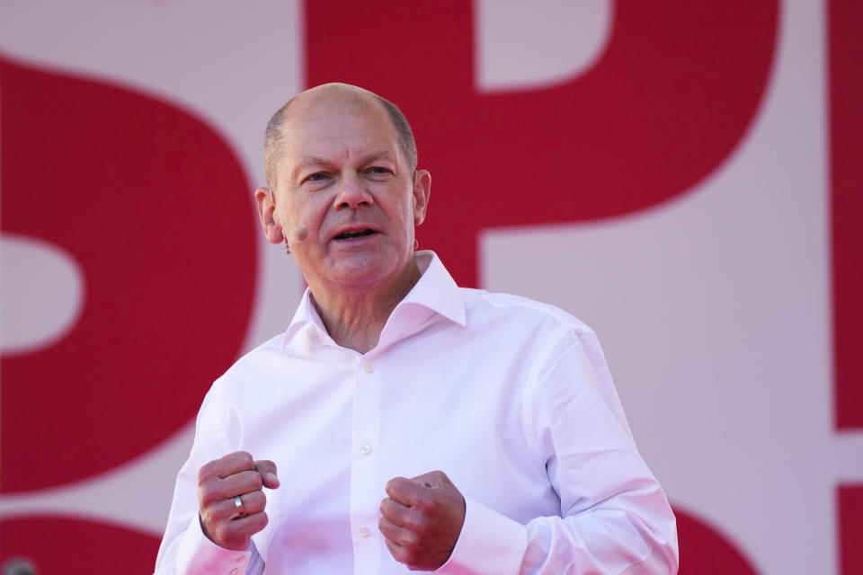 FILE - In this Friday, Aug. 27, 2021 file photo, Germany's Social Democratic Party candidate for chancellor in the upcoming national elections Olaf Scholz speaks during an election campaign event in Berlin, Germany. National election take place in Germany on Sept. 26, 2021. Germany's election campaign has largely focused on the three candidates hoping to succeed Angela Merkel as chancellor after four terms in office, Annalena Baerbock for the Greens, Armin Laschet for the Christian Union parties and Olaf Scholz for the Social Democrats. German elections will be on Sept.26. (AP Photo/Markus Schreiber, Pool, File)