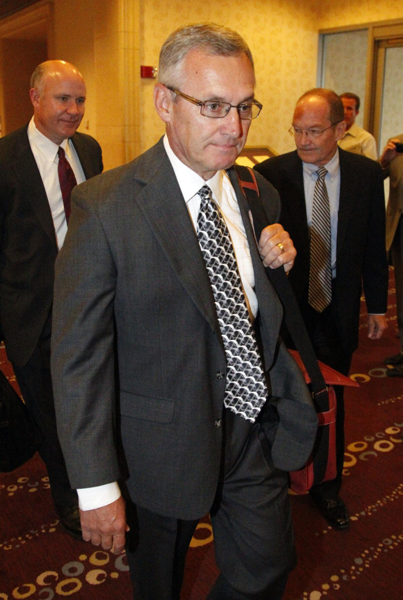 Former Ohio State football coach Jim Tressel arrives for a hearing in Indianapolis, Ind., Friday, Aug. 12, 2011. Tressel had hoped to travel to Indianapolis to be a central figure at the inaugural Big Ten championship game in December.  Instead, he's in the city to testify about his role in NCAA violations which have shaken the foundation of Ohio State's powerhouse football program and cost him his job.  (AP Photo/Michael Conroy)