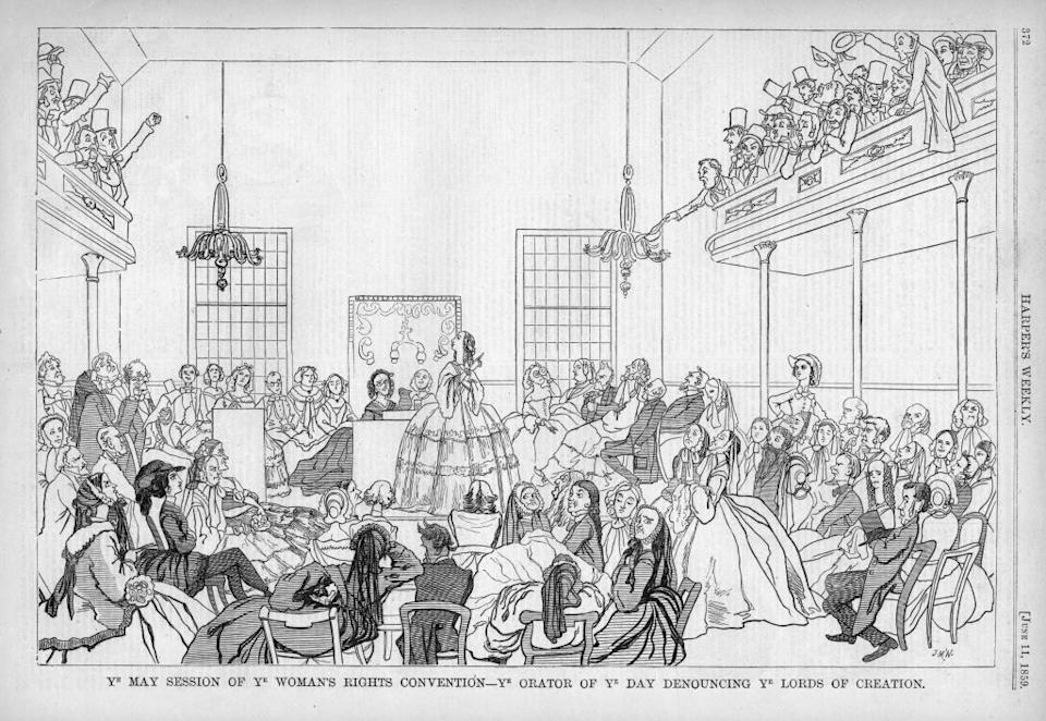 """A circa 1859 <i>Harper's Weekly</i> caricature satirizing the 1848 women's rights Convention in Seneca Falls, New York, captioned """"Ye May Session of Ye Woman's Rights Convention - ye orator of ye day denouncing ye lords of creation, """" suggesting that suffrage is contrary to religious and natural law.<span class=""""copyright"""">Ken Florey Suffrage Collection/Gado—Getty Images</span>"""