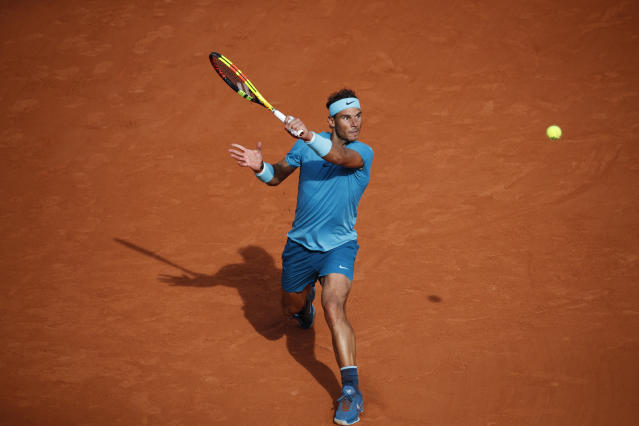Spain's Rafael Nadal returns a shot against Argentina's Juan Martin del Potro during their semifinal match of the French Open tennis tournament at the Roland Garros stadium in Paris, France, Friday, June 8, 2018. (AP Photo/Christophe Ena)