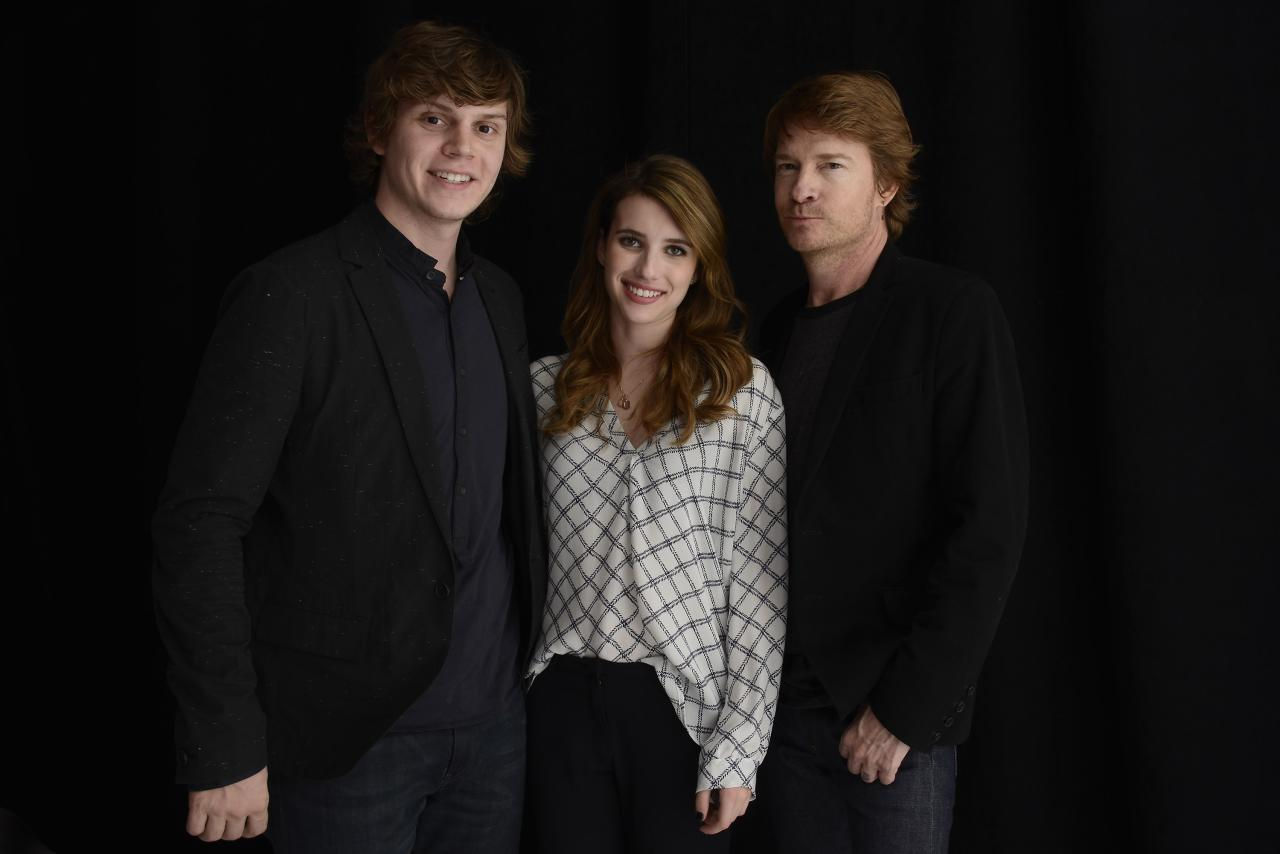 NEW YORK, NY - APRIL 17:  Actors Emma Roberts and Evan Peters pose with Director Scott Coffey of the film Adult World at the Tribeca Film Festival 2013 portrait studio on April 17, 2013 in New York City.  (Photo by Larry Busacca/Getty Images)