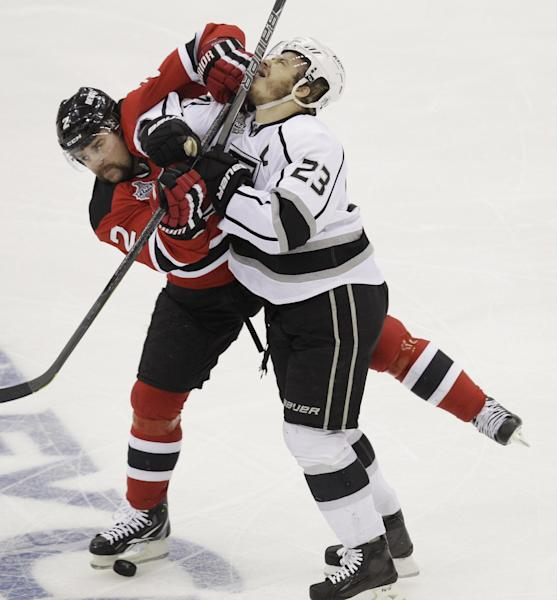 New Jersey Devils' Marek Zidlicky, of Czech Republic, collides with Los Angeles Kings' Dustin Brown in the first period during Game 5 of the NHL hockey Stanley Cup finals, Saturday, June 9, 2012, in Newark, N.J.. (AP Photo/Kathy Willens)
