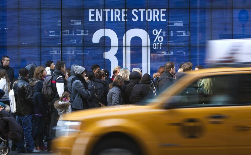 People line up to get into a store on 5th Ave. looking for Black Friday sales in New York