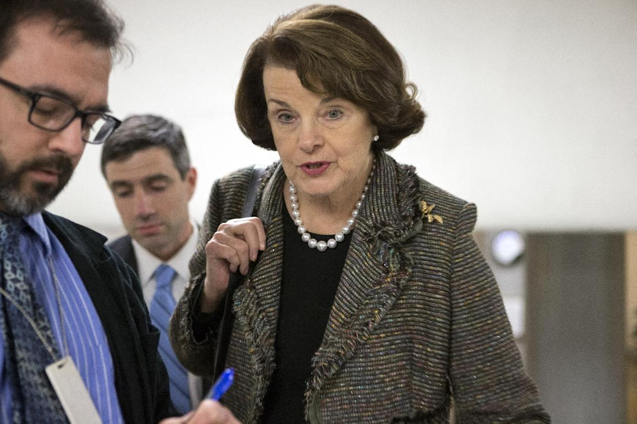 Senate Intelligence Committee Chairman Dianne Feinstein, D-Calif., is interviewed by reporters as senators return to Capitol Hill after a week away from Washington with just three legislative days until automatic budget cuts are scheduled to take effect, Monday, Feb. 25, 2013. The Senate is also moving toward a vote Tuesday on President Barack Obama's divisive choice of Chuck Hagel to head the Defense Department after a protracted political fight. (AP Photo/J. Scott Applewhite)
