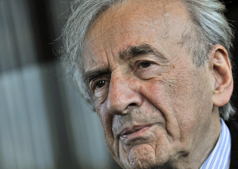 FILE - In this Dec. 10, 2009 file photo, Holocaust survivor and Nobel Peace Prize winning author Elie Wiesel listens during an interview with The Associated Press in Budapest, Hungary. Wiesel says he's ìrepudiatingî a Hungarian state award he received in 2004 because top officials in Budapest recently attended a ceremony for a Nazi sympathizer. (AP Photo/Bela Szandelszky)