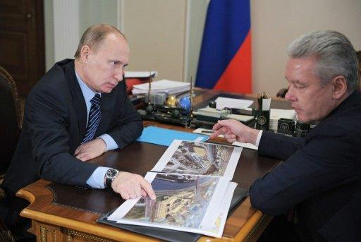 Prime Minister Vladimir Putin, pictured with Moscow Mayor Sergei Sobyanin, plans to toughen up immigration legislation, saying those who want to work in Russia will have to pass basic tests