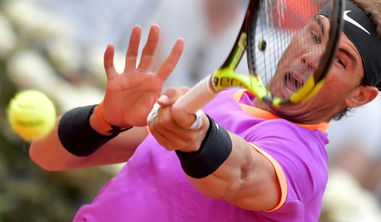Rafael Nadal of Spain hits a return to Dominic Thiem of Austria during their quarter-final tennis match at the ATP Tennis Open tournament on May 19, 2017 at the Foro Italico in Rome