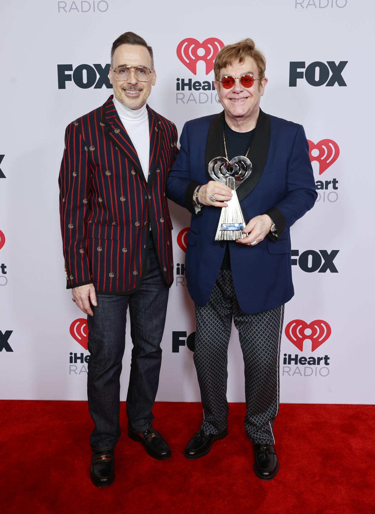 Sir Elton John and David Furnish married in 2014. (Photo by Emma McIntyre/Getty Images for iHeartMedia)