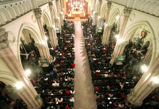 Thousands of Catholics gather for mass at a church in Shanghai. A newly ordained Chinese bishop has not been seen since he quit the state-sanctioned Catholic association on the weekend, amid new tensions between Beijing and the Vatican, reports said on Tuesday