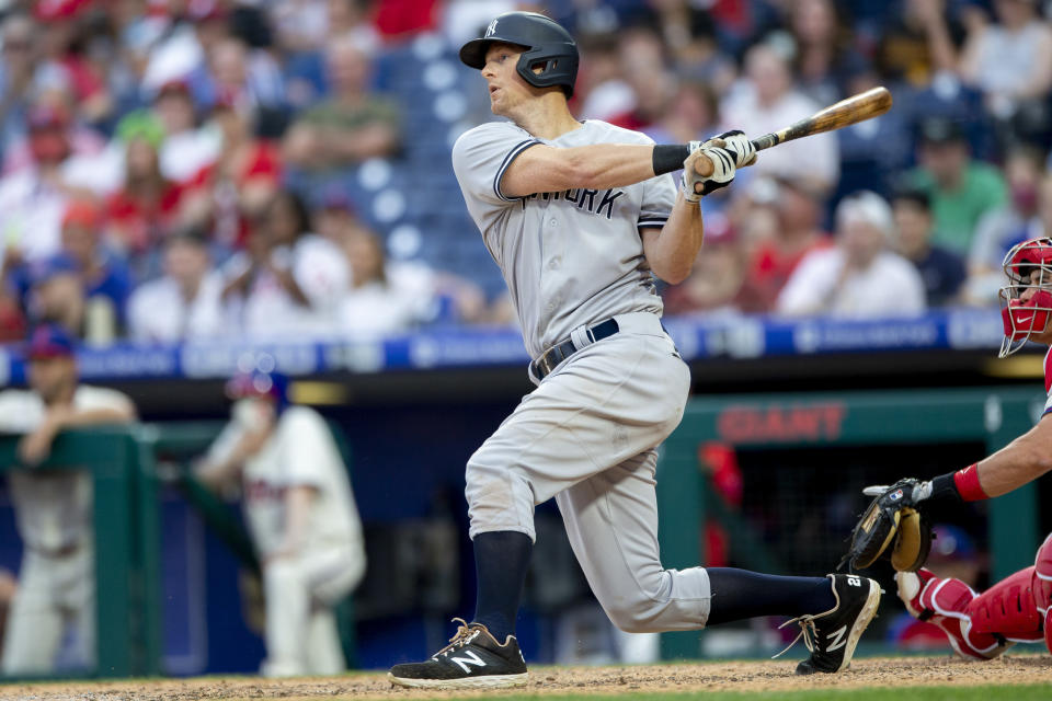 New York Yankees' DJ LeMahieu (26) hits a three-run home run in the ninth inning of a baseball game against the Philadelphia Phillies, Saturday, June 12, 2021, in Philadelphia. (AP Photo/Laurence Kesterson)