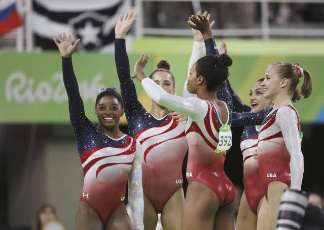 2016 Rio Olympics - Artistic Gymnastics - Final - Women's Team Final - Rio Olympic Arena - Rio de Janeiro, Brazil - 09/08/2016. Simone Biles (USA) of USA, Gabrielle Douglas (USA) of USA (Gabby Douglas), Madison Kocian (USA) of USA, Alexandra Raisman (USA) of USA (Aly Raisman) and Laurie Hernandez (USA) of USA celebrate winning the gold in the women's team final. REUTERS/Damir Sagolj FOR EDITORIAL USE ONLY. NOT FOR SALE FOR MARKETING OR ADVERTISING CAMPAIGNS.