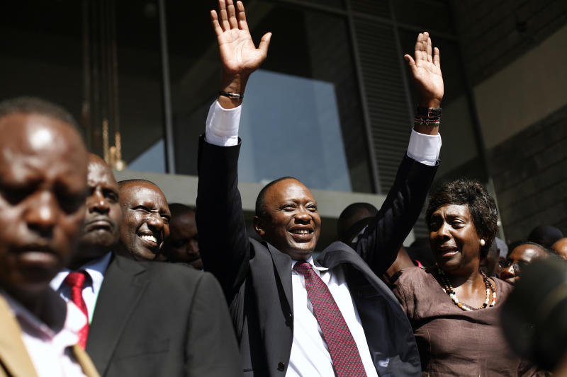 Kenyan president-elect Uhuru Kenyatta waves at supporters after winning the elections in Nairobi, Kenya, Saturday, March 9, 2013. Kenya's election commission posted complete results early Saturday showing that Deputy Prime Minister Kenyatta prevailed in the country's presidential elections by the slimmest of margins, winning 50.03 percent of the vote. (AP Photo/Jerome Delay)