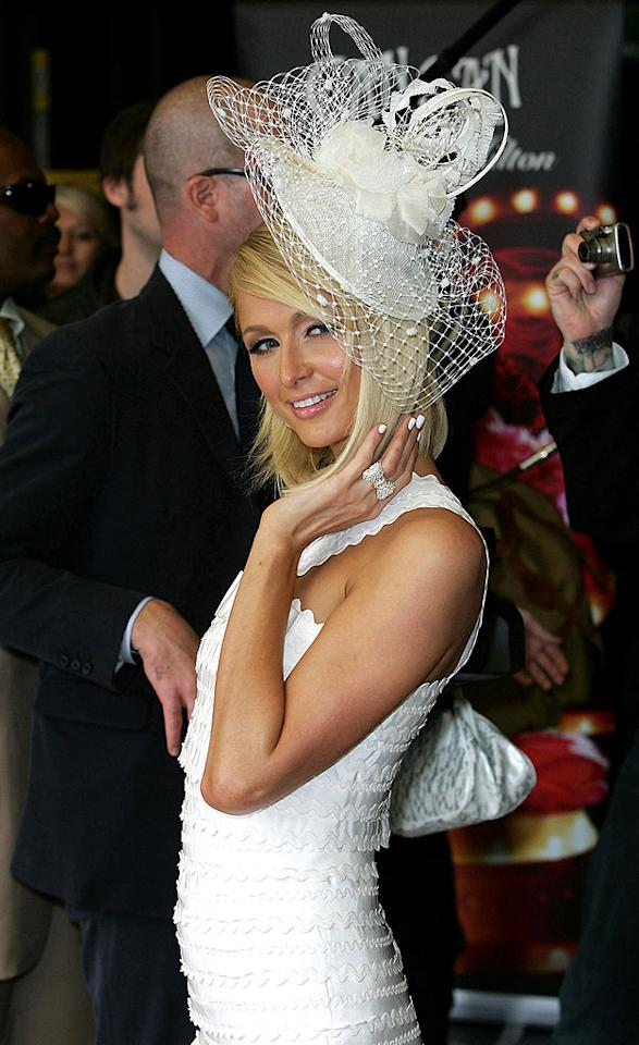"""Despite numerous attempts to become a fashion icon, Paris Hilton continues to embarrass herself in public with missteps like this. Her wedding cake catastrophe of a hat looks edible, not wearable. Ferdaus Shamim/<a href=""""http://www.wireimage.com"""" target=""""new"""">WireImage.com</a> - May 15, 2008"""