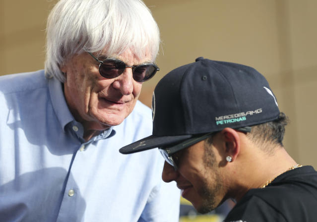 "FILE - In this Thursday, April 16, 2015 file photo, Bernie Ecclestone, President and CEO of Formula One Management, left, talks to Mercedes driver Lewis Hamilton of Britain ahead the Bahrain Formula One Grand Prix at the Formula One Bahrain International Circuit in Sakhir, Bahrain. Formula One champion Lewis Hamilton has criticized ""ignorant and uneducated"" comments by former F1 boss Bernie Ecclestone. Hamilton, a six-time world champion and the only Black driver in F1, was shocked by Ecclestone's claim during an interview with broadcaster CNN on Friday, June 26, 202 that ""in lots of cases, Black people are more racist"" than white people. (AP Photo/Kamran Jebreili, File)"