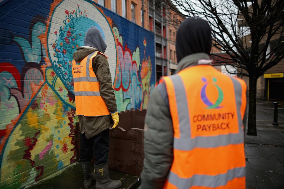 MANCHESTER, UNITED KINGDOM - FEBRUARY 26:  Young offenders do manual work erecting a flower display box as part of a Community Payback Scheme on February 26, 2015 in Manchester, United Kingdom. As the United Kingdom prepares to vote in the May 7th general election  many people are debating some of the many key issues that they face in their life, employment, the NHS, housing, benefits, education, immigration, 'the North South divide, austerity, EU membership and the environment.  (Photo by Christopher Furlong/Getty Images)