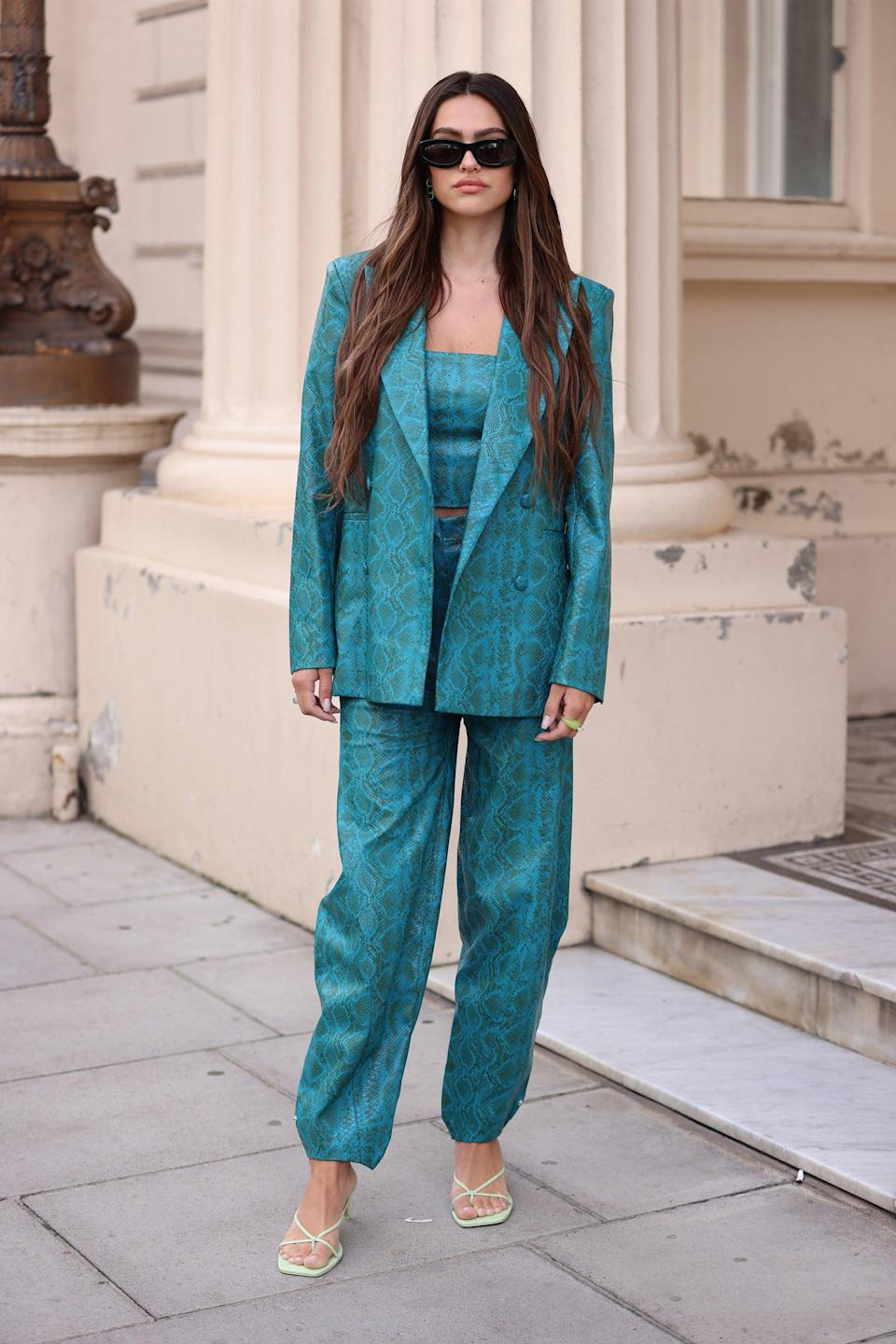 """Turquoise colour blocking is at its best in a matching three-piece textural trouser suit.<span class=""""copyright"""">Photo Courtesy of Neil Mockford/Getty Images.</span>"""