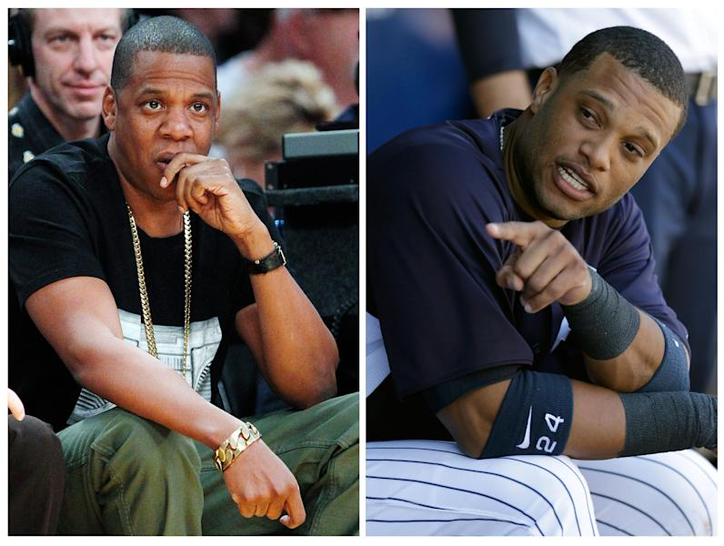 In this photo combo of file photos, Jay-Z, left, watches an NBA basketball game in Los Angeles on Jan. 27, 2013. New York Yankees' Robinson Cano sits in the dugout during a spring training baseball game in Tampa, Fla., on March 28, 2013. Cano plans to switch agents from Scott Boras to a new company formed by musician Jay-Z's Roc Nation and CAA Sports. (AP Photo/Reed Saxon, left, and Kathy Willens, File)