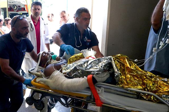 <p>Emergency workers use a trolley to take a person injured in an earthquake on the Greek island of Kos as they arrive for treatment on the island of Crete in Heraklion on July 21, 2017. (Photo: Costas Metaxakis/AFP/Getty Images) </p>
