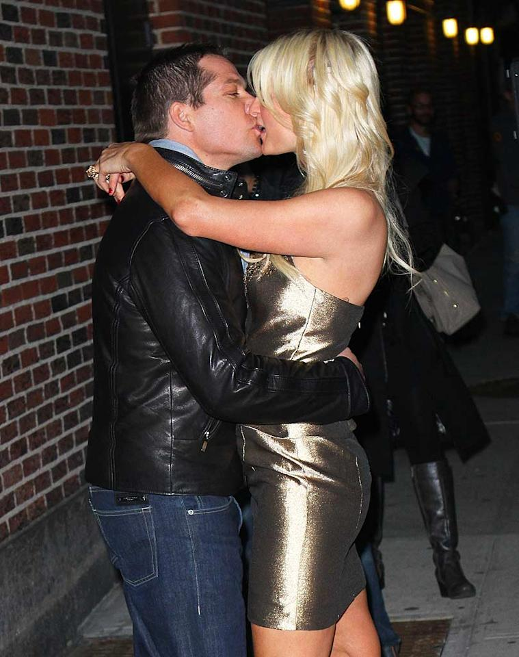 """Paris shared a smooch with Cy Waits after the show. During the heiress' on-air interview, Letterman poked fun at her main squeeze who was hanging out in the green room. """"Mr. Big Shot is back there in his Member's Only jacket, but look what I have for you,"""" said Dave as he handed the birthday girl a bouquet of roses. Richie Buxo/<a href=""""http://www.splashnewsonline.com/"""" target=""""new"""">Splash News</a> - February 17, 2011"""