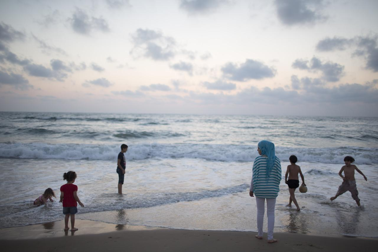 TEL AVIV, ISRAEL - JULY 25: (ISRAEL OUT) Children bathe in the sea as Muslim worshippers break their day-long fast during a 'Iftar' meal on July 25, 2013 in in Jaffa, a suburb of Tel Aviv, Israel. Muslims fasting in the month of Ramadan must abstain from food, drink and sex from dawn to dusk, when they break the fast with a meal known as Iftar. (Photo by Uriel Sinai/Getty Images)