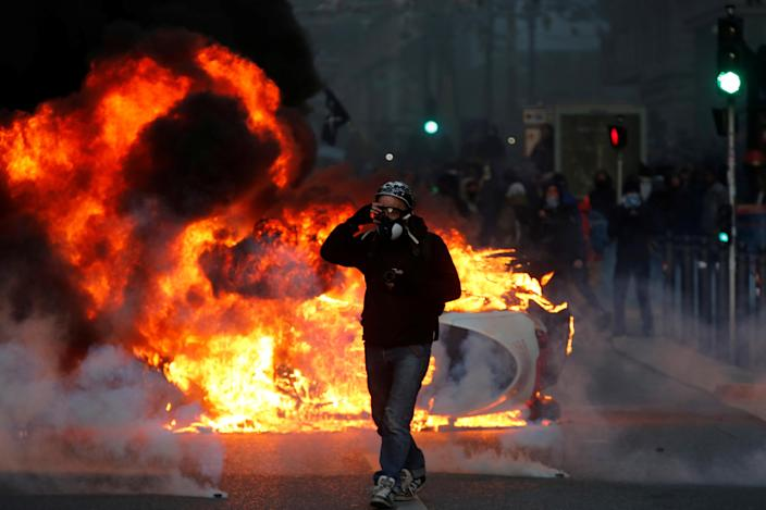 """A car burns during during clashes with police at a demonstration of the """"yellow vests"""" movement in Marseille, France, Dec. 8, 2018. (Photo: Jean-Paul Pelissier/Reuters)"""