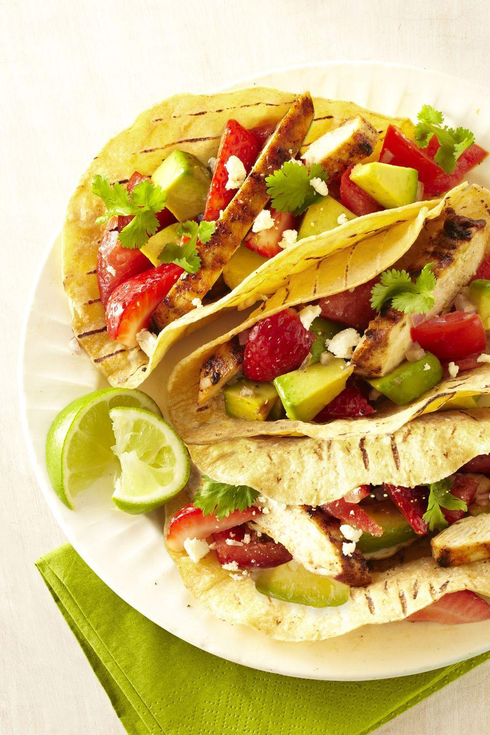 """<p>Sweet strawberries and creamy avocado make a luscious yet light topping for these chicken tacos.</p><p><em><a href=""""https://www.goodhousekeeping.com/food-recipes/a14533/grilled-chicken-tacos-strawberry-salsa-recipe-ghk0713/"""" rel=""""nofollow noopener"""" target=""""_blank"""" data-ylk=""""slk:Get the recipe for Grilled Chicken Tacos with Strawberry Salsa »"""" class=""""link rapid-noclick-resp"""">Get the recipe for Grilled Chicken Tacos with Strawberry Salsa »</a></em><strong><br></strong></p><p><strong>RELATED:</strong> <a href=""""https://www.goodhousekeeping.com/food-recipes/g1137/fresh-strawberry-recipes/"""" rel=""""nofollow noopener"""" target=""""_blank"""" data-ylk=""""slk:20 Delicious Strawberry Recipes to Make This Spring and Summer"""" class=""""link rapid-noclick-resp"""">20 Delicious Strawberry Recipes to Make This Spring and Summer</a></p>"""