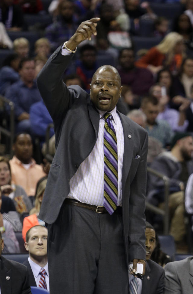 Charlotte Bobcats acting head coach Patrick Ewing directs his team as they play the New York Knicks in the first half of an NBA basketball game in Charlotte, N.C., Friday, Nov. 8, 2013. Ewing is filling in for Bobcats coach Steve Clifford who is hospitalized. (AP Photo/Nell Redmond)