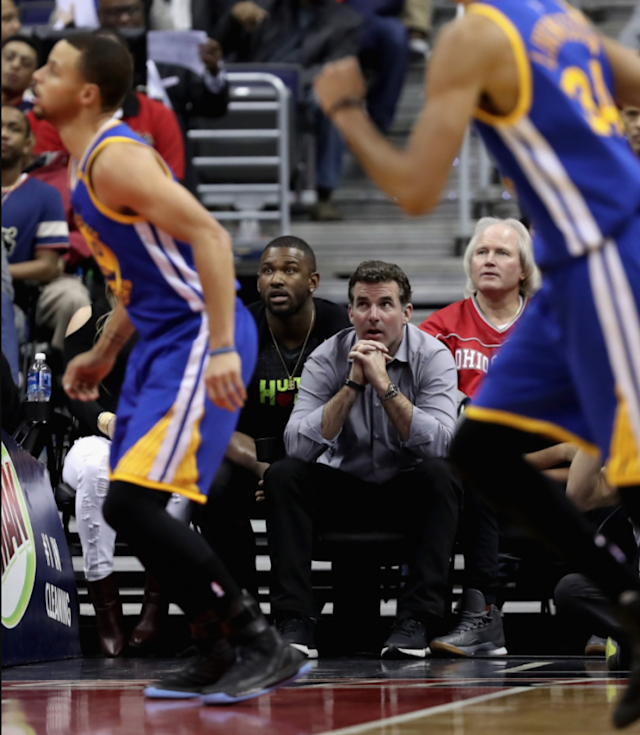Under Armour CEO Kevin Plank watches Under Armour athlete Steph Curry (Getty)