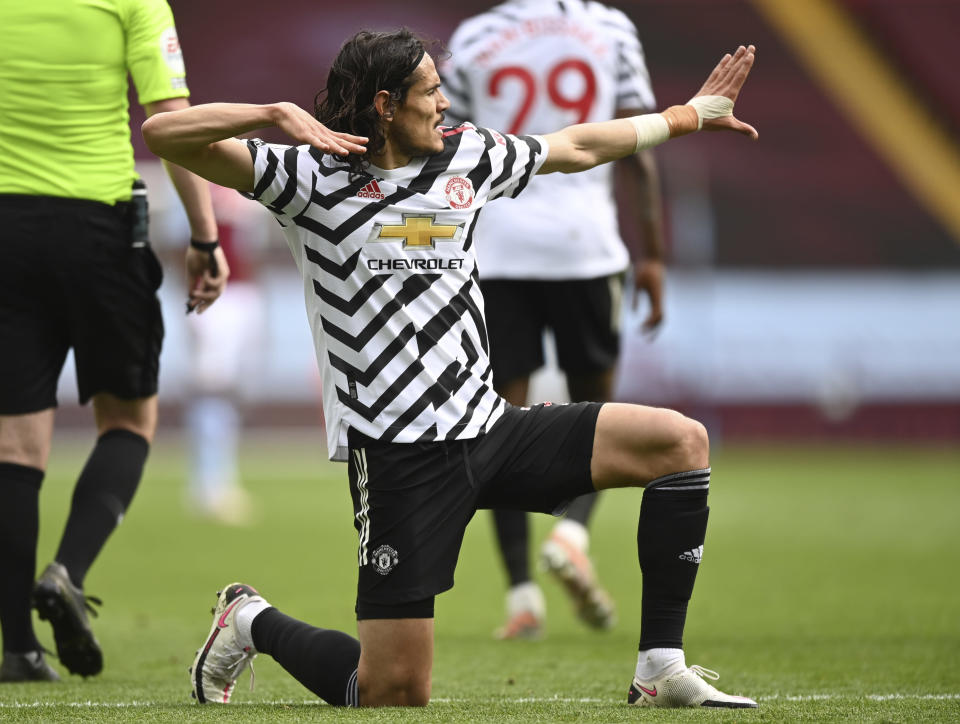 Manchester United's Edinson Cavani celebrates after scoring his side's third goal during the English Premier League soccer match between Aston Villa and Manchester United at Villa Park in Birmingham, England, Sunday, May 9, 2021. (Shaun Botterill/Pool via AP)