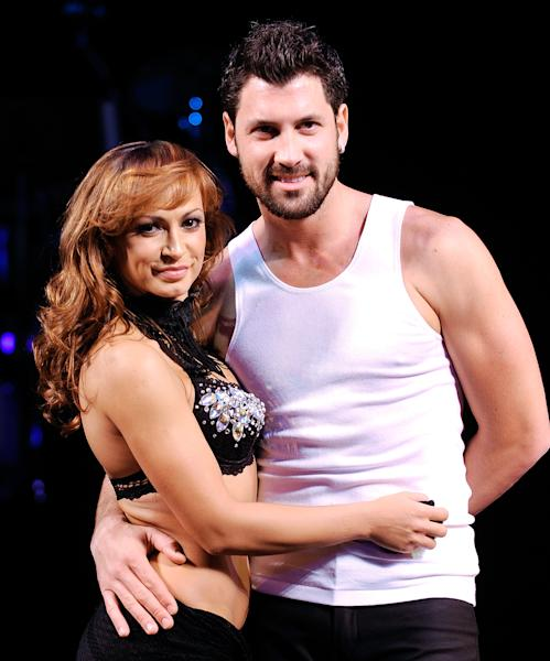 "FILE - This July 24, 2009 file photo shows dancers Karina Smirnoff, left, and Maksim Chmerkovskiy, during a press preview for the Broadway ballroom dance show ""Burn The Floor"" in New York. ""Dancing with the Stars"" duo Smirnoff and Chmerkovskiy have hopped aboard the Broadway-bound ""Forever Tango."" Producers said Wednesday, July 19, 2013, the pair will perform in the show at the Walter Kerr Theatre from July 9-28. (AP Photo/Evan Agostini, file)"