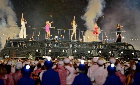 LONDON, ENGLAND - AUGUST 12:  (L-R) Melanie Chisholm, Emma Bunton, Melanie Brown, Geri Haliwell and Victoria Beckham of the Spice Girls perform during the Closing Ceremony on Day 16 of the London 2012 Olympic Games at Olympic Stadium on August 12, 2012 in London, England.  (Photo by Jeff J Mitchell/Getty Images)