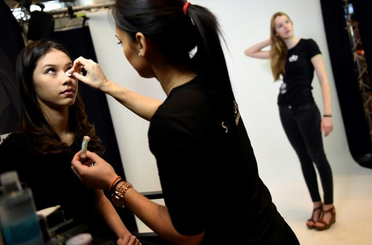 A woman is made up during a 2015 Elite Model Look casting in Paris