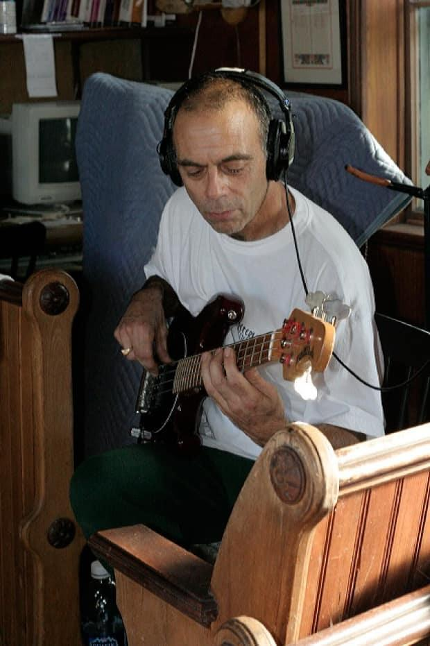 Paul Boudreau during a recording session with the Glamour Puss Blues Band. (Submitted by Glamour Puss Blues Band - image credit)
